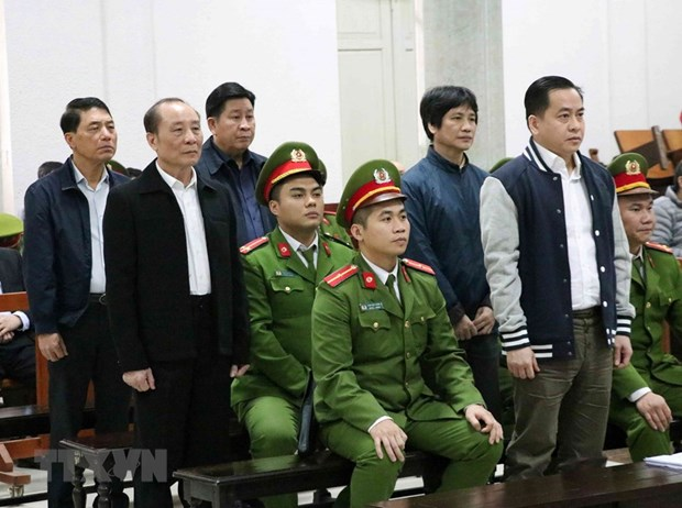 Former public security officers brought to trial in Hanoi hinh anh 1