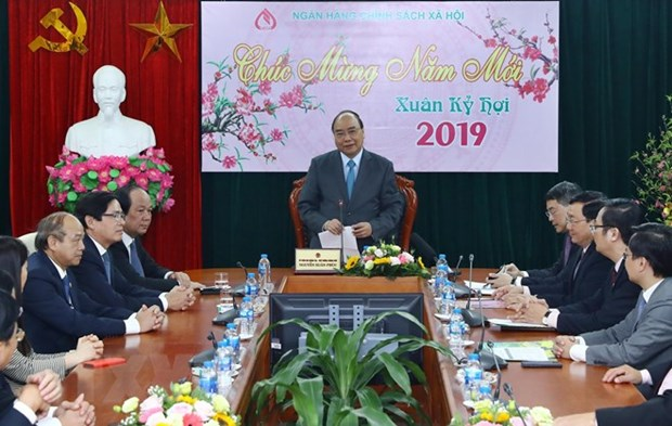 PM lauds bank's contributions to poverty reduction hinh anh 1