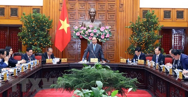 Prime Minister commends efforts to ensure happy Tet for all hinh anh 1