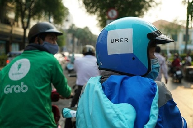 Vietnamese authorities to probe Grab-Uber deal again hinh anh 1