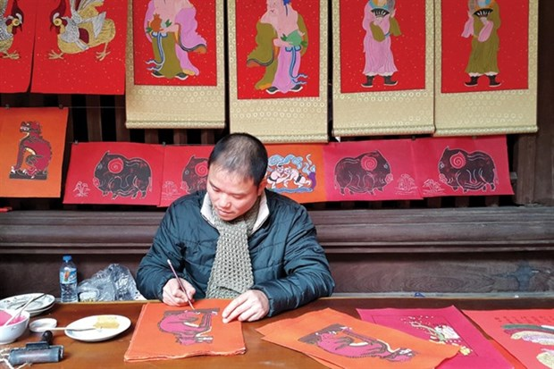 Traditional folk painting enjoys a revival hinh anh 1