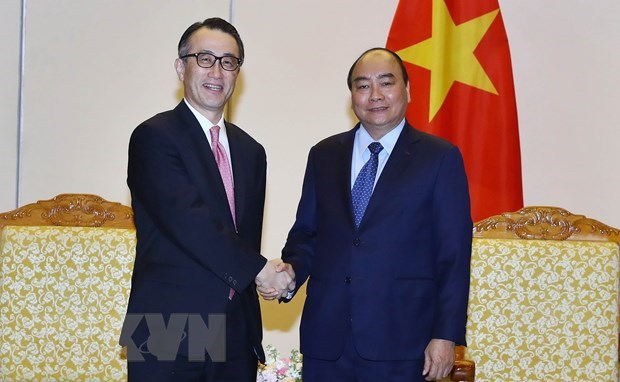 PM pledges optimal conditions for Japanese MUFG Bank in Vietnam hinh anh 1