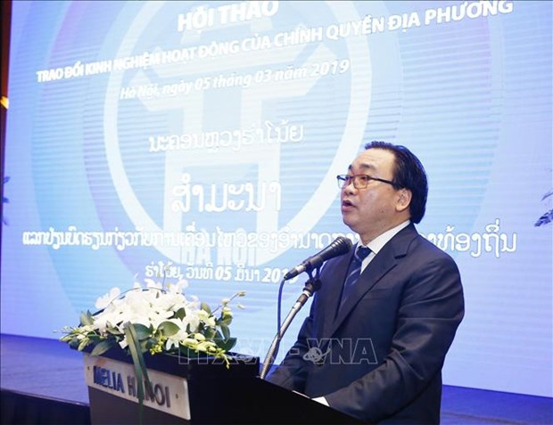 Vietnam, Laos share experience in local government activities hinh anh 1