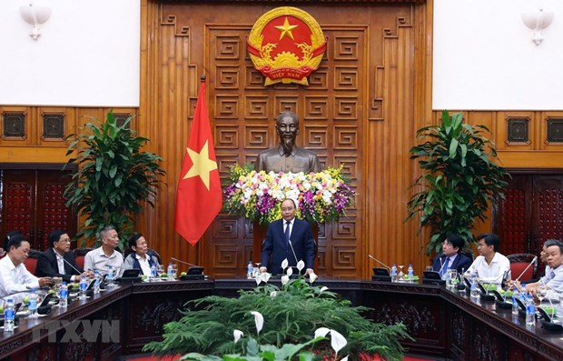 Party, State always remember contributors to revolution: PM hinh anh 1