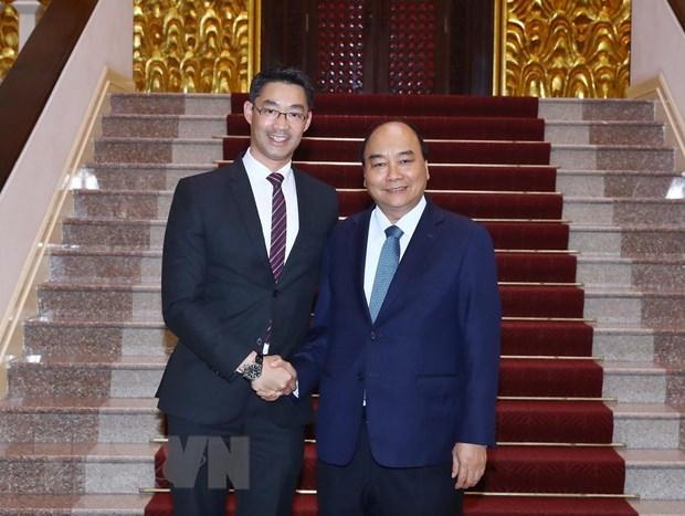 PM Nguyen Xuan Phuc meets economist Philipp Rosler hinh anh 1