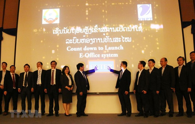 Vietnamese telecom group helps Laos apply E-Office system hinh anh 1