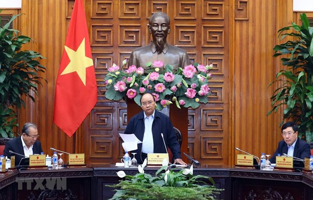 PM urges more drastic actions to promote production, business hinh anh 1