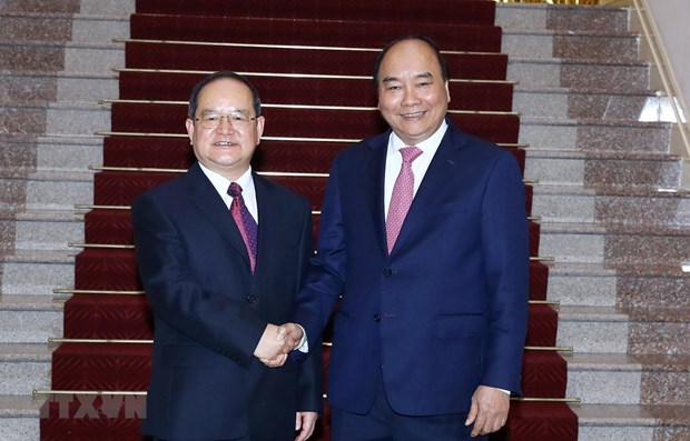 Prime Minister meets party chief of Guangxi's Zhuang autonomous region hinh anh 1