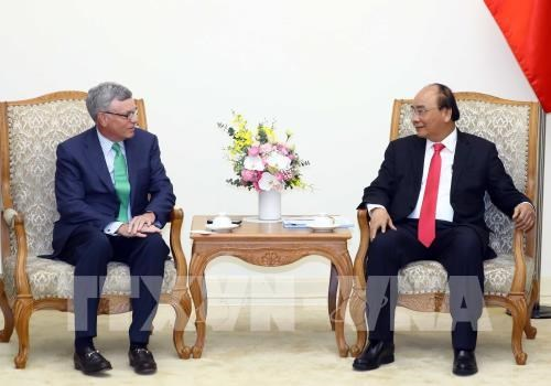 Government leader hosts Visa CEO hinh anh 1