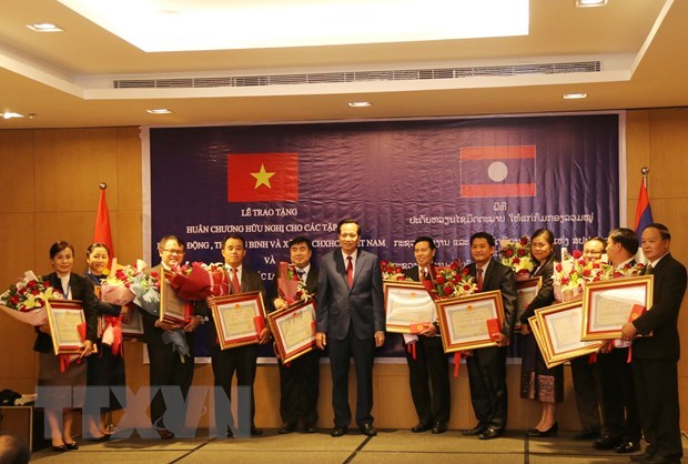Vietnam, Laos discuss boosting labour, social welfare cooperation hinh anh 1