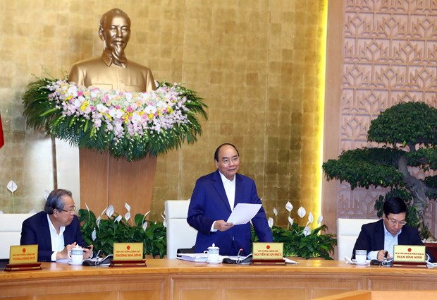 PM urges strong, substantive improvement of business climate hinh anh 1