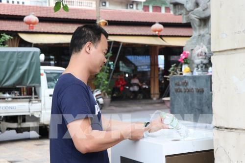Drinking water taps installed in Hanoi's centre hinh anh 1