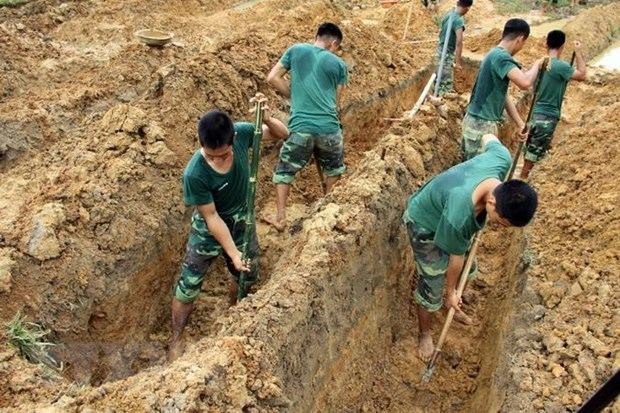 Quang Tri: remains of 20 war martyrs collected hinh anh 1