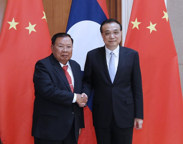 China willing to step up cooperation with Laos hinh anh 1