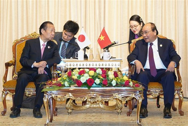 PM meets Japanese ruling party chief on BRF sidelines hinh anh 1