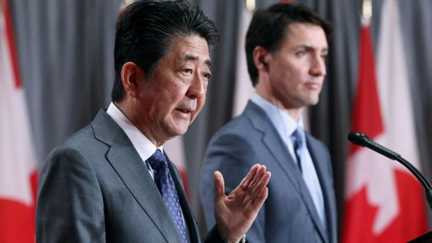 Japanese, Canadian PMs underline benefits of CPTPP hinh anh 1