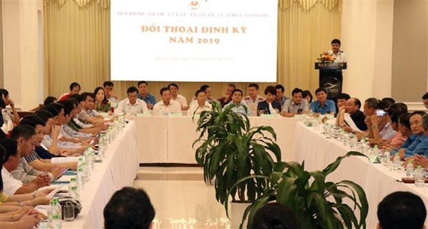 Dialogue seeks ways to improve labour safety, hygiene hinh anh 1