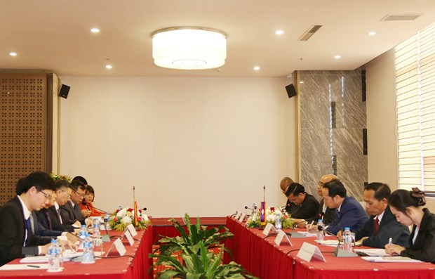 Vietnam, Lao commissions boost communication cooperation hinh anh 1