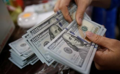 Reference exchange rate down 8 VND on May 16 hinh anh 1