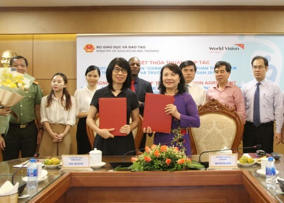Ministry, World Vision join hands to end violence against children hinh anh 1
