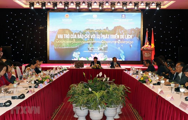 Role of Vietnamese, Lao media in tourism development discussed hinh anh 1