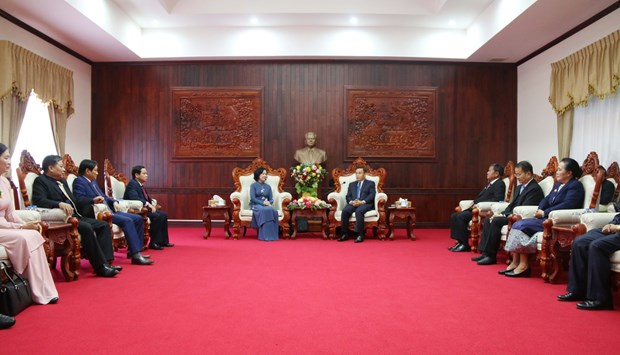 Vietnam, Laos share experience in mass mobilisation work hinh anh 1