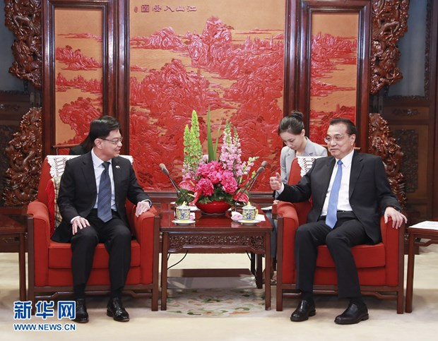 Singapore, China partner to safeguard multilateral trade system hinh anh 1