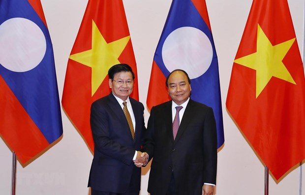 Vietnam, Laos resolved to create breakthrough in trade hinh anh 1