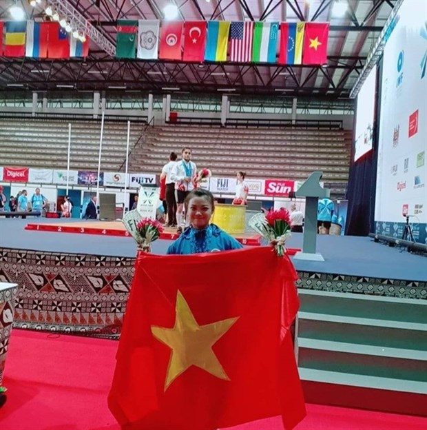 Vietnamese weightlifters win gold at world championship hinh anh 1