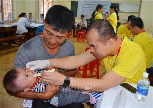 Children receive free correction of facial deformity, gifts hinh anh 1