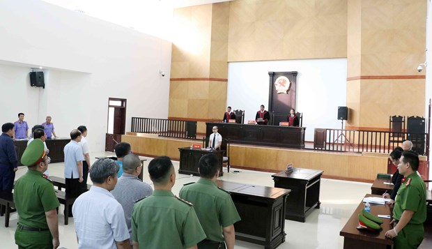 Two former public security officers have jail sentences reduced hinh anh 1