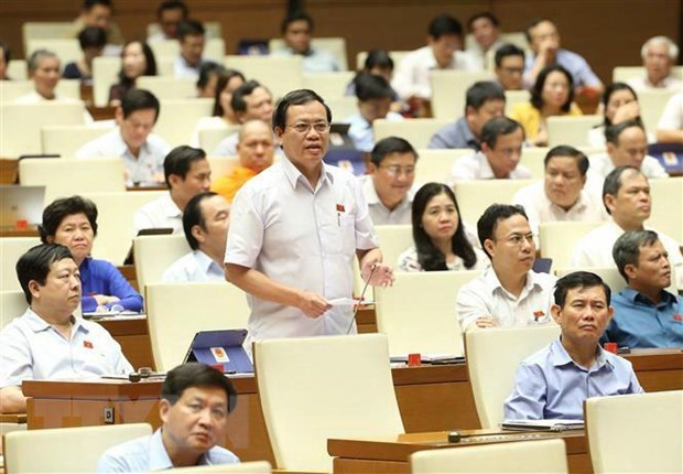 NA deputies vote on three laws, discuss two bills hinh anh 1