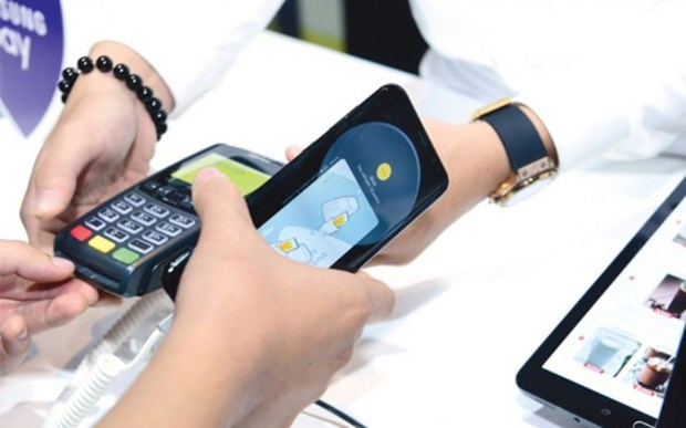 Payments for electricity bills go cashless hinh anh 1