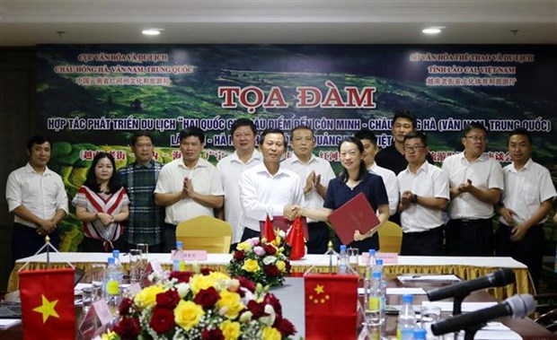 Lao Cai, Chinese locality bolster tourism cooperation hinh anh 1