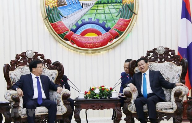 Deputy PM Dung meets Lao Prime Minister, NA Chairwoman hinh anh 1