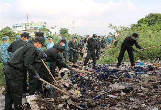 Over 22,000 members of armed forces join volunteer campaign hinh anh 1
