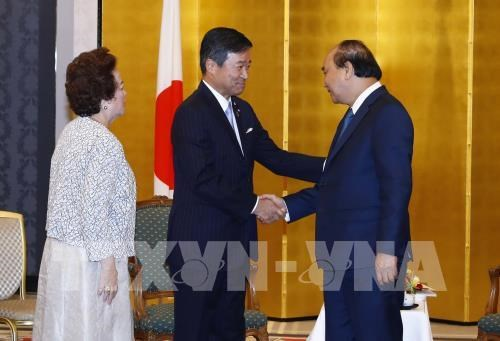 PM meets with leaders of Japanese conglomerates hinh anh 4