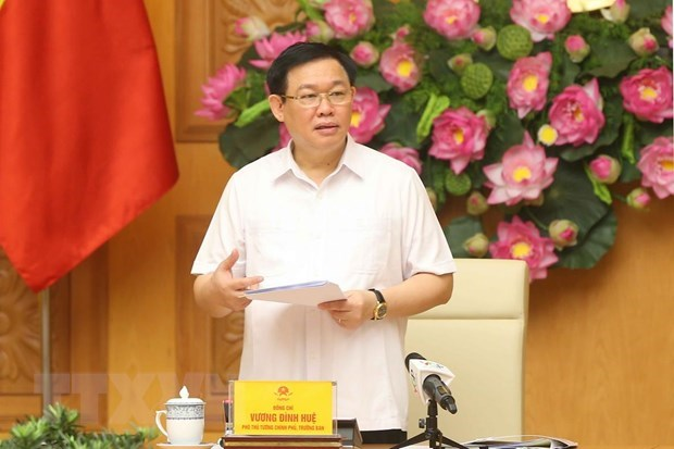 Deputy PM reviews SOEs equitisation, restructuring hinh anh 1
