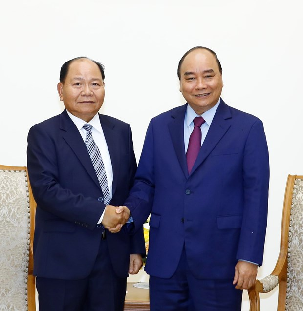 Prime Minister hosts Lao Minister of Home Affairs hinh anh 1