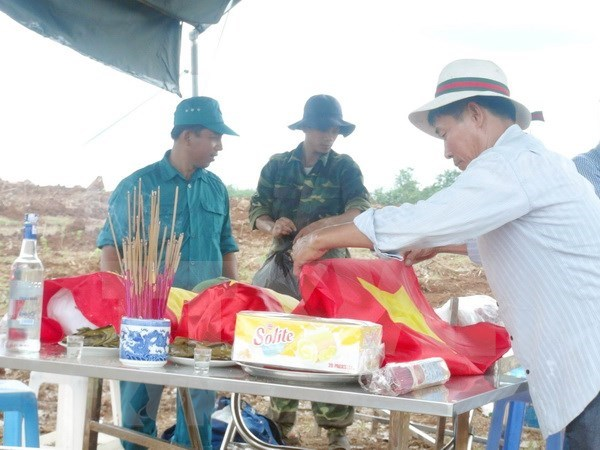Remains of Vietnamese volunteer soldiers in Cambodia repatriated hinh anh 1