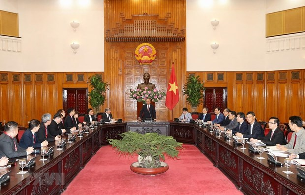 Vietnam pledges support for Singaporean investments: PM hinh anh 1