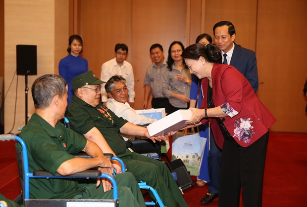 Parliamentary leader hails war invalids' continued dedication hinh anh 1