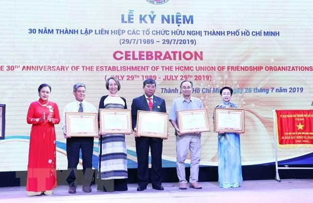 HCM City Union of Friendship Organisations marks 30th anniversary hinh anh 1