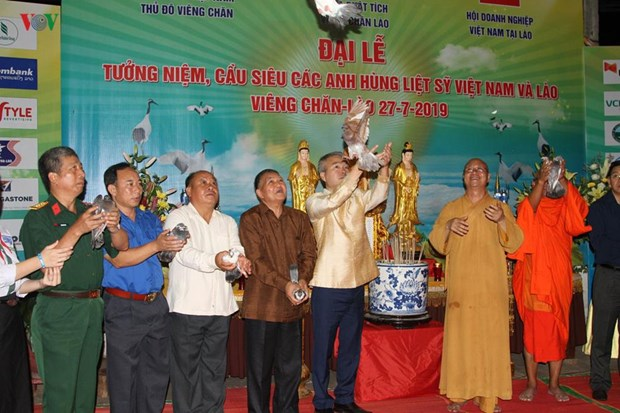 Requiems for fallen soldiers held overseas hinh anh 1