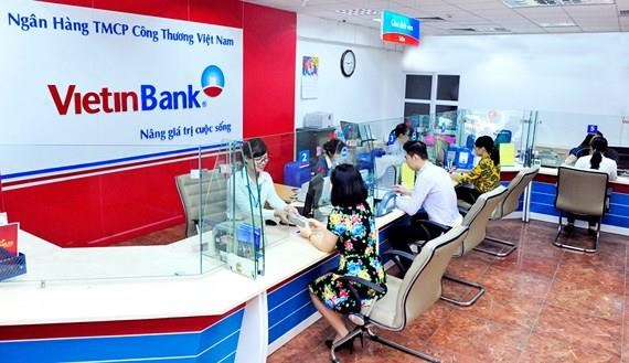 Banks unexpectedly cut lending rates to aid businesses hinh anh 1