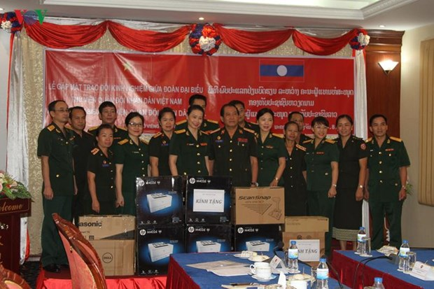 Military libraries of Vietnam, Laos foster collaboration hinh anh 1