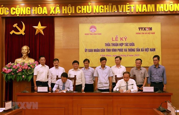 News agency, Vinh Phuc sign communication cooperation agreement hinh anh 1