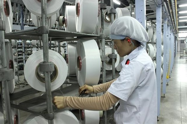 How does yuan price reduction affect garment, footwear industries? hinh anh 1