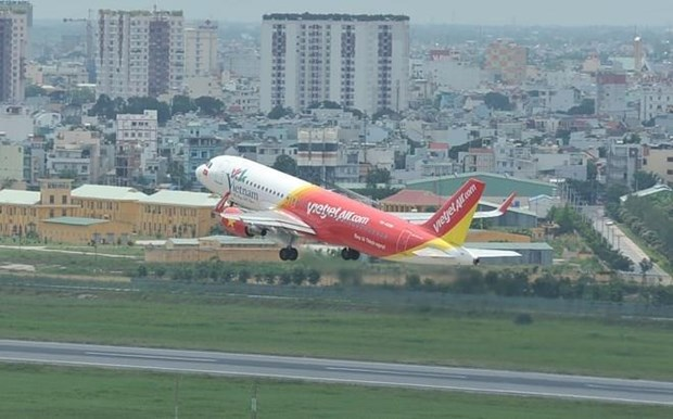 Vietjet named in Forbes' top 50 listed Vietnamese companies. hinh anh 1