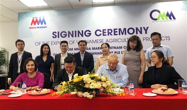 Deal signed to boost Vietnamese farm produce exports to Singapore hinh anh 1